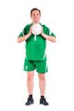 Posera för sportswear för mogen man iklätt grönt Arkivbilder