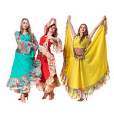 Posera för tre kvinnligt dansare som in isoleras på vit Arkivbild