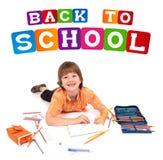 posera skolatema för tillbaka pojke till Arkivbild