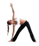 Posera yoga för skönhetung flicka i konditiondräkt Arkivfoton