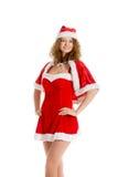 Poses de fille de Santa dans la robe de Noël Photos stock