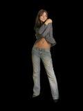 Poses de jeune fille restant d'isolement sur le noir Image libre de droits