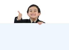 Posetive kid. Hold a big card stock photo