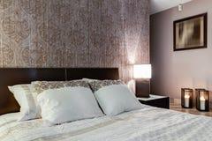 Posh bedroom with elegant walpaper Stock Images