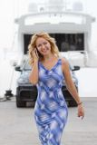 Posh blond girl walks near yacht Stock Photography