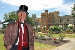 Posh country gent in castle garden. Photo of a posh country gent wearing high society attire posing in the grounds of his castle mansion in kent england Stock Images