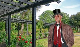 Posh country gent in garden. Photo of a posh country gent wearing high society attire posing in the grounds of his castle mansion in kent england Royalty Free Stock Photos