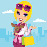 Posh Girl and Chihuahua. Blonde posh girl with chihuahua carrying shopping bags and wearing stylish pink fashion clothes Stock Images