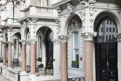 Posh luxury English apartment doors in London royalty free stock photography
