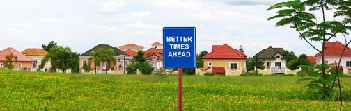 Posh village in suburban Manila with a better times ahead sign. Posh village in suburban Manila Italian modern house design with a better times ahead sign Stock Image