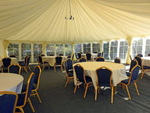 Posh wedding marquee reception tent. Photo of a posh wedding marquee tent all ready to receive the newly weds and their guests for reception august 2017 royalty free stock photography