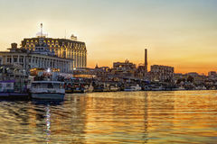 Poshtova Square at sunset. Kiev, Ukraine - August 9, 2016: View on the river bank of Poshtova Square and River Station at sunset. Tourists like to take a boat stock image