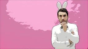 Posição bonita do menino em um fundo cor-de-rosa Durante isto vestido em uma camisa branca Guardar uma cenoura quer queimá-la video estoque