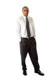 Posição considerável do homem de negócio Foto de Stock