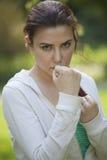Posição da luta interna da mulher da aptidão Imagem de Stock Royalty Free