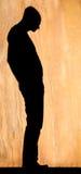 Posição do homem da silhueta Foto de Stock Royalty Free