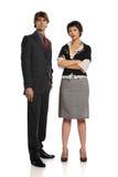 Posição do homem de negócios e da mulher de negócios Fotos de Stock Royalty Free