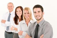 Posição feliz da equipe do negócio na linha retrato Imagens de Stock