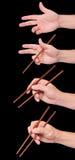 Posições do preto do sushi do chopstick Fotografia de Stock Royalty Free