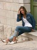 posiedzenie dziewczyny Zdjęcia Stock