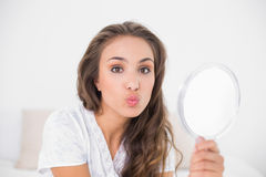 Posing attractive brunette holding mirror Royalty Free Stock Image