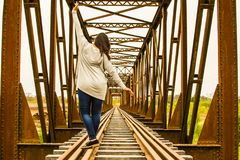 Lone and adventurous girl walks balancing on the rails stock photos