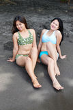 Posing on the Beach. Two Asian Beauty Sitting on the Beach with a Smile royalty free stock photos