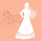 Posing Bride. Bride with veil posing - dress has movern applique across bottom and as background element Royalty Free Stock Photo