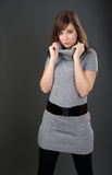 Posing in Brown Sweater Dress Royalty Free Stock Images