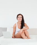 Posing brunette with a laptop Stock Images
