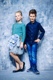 Posing children. Kid`s fashion. Two modern children posing together at studio. Clothes for children. Easter holidays Stock Photos