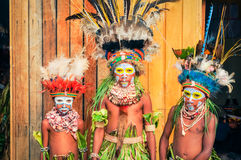 Posing children in Papua New Guinea. Hagen show, Papua New Guinea - circa August 2015: Three native children with colours on their faces during Hagen show, Papua Stock Image