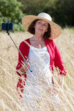 Posing for countryside selfy for mature woman vacation Royalty Free Stock Image
