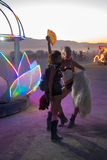 Posing couple of Lady's Burning Man Festival 2012 Royalty Free Stock Image