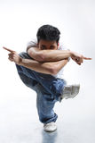 Posing dancer. Stylish and cool looking breakdancer jumping Royalty Free Stock Photos