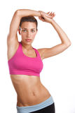 Posing fit woman. A fit woman in athletic clothing poses for the camera Stock Photography