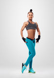 Posing fitness bodybuilder woman Stock Image