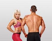 Posing fitness couple Royalty Free Stock Photo