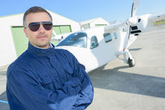 Posing at front private plane Royalty Free Stock Image