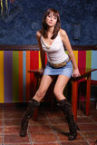 Posing girl. Young woman posing in a pub Stock Photo