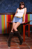 Posing girl. Young woman posing in a pub Royalty Free Stock Photography