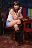 Posing girl. Young woman posing in a pub Royalty Free Stock Photo
