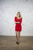 Posing Girl in red party dress Stock Photos
