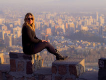 Posing girl. Girl posing for tourist photo with the city of Santiago de Chile in the background Stock Photos
