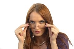 Posing with glasses. Beautiful girl posing with glasses on white royalty free stock photos