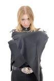 Posing gothic girl with bat-like sleeves. Isolated on white Royalty Free Stock Photos