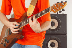 Posing hands of musician playing the electric guitar Stock Photography