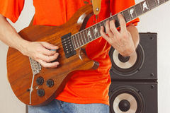 Posing hands of musician playing the guitar Stock Image