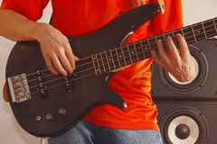Posing hands of rock musician playing the bass guitar Royalty Free Stock Photography