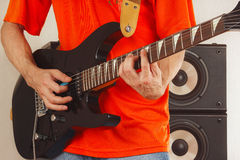 Posing hands of rock musician playing the guitar Royalty Free Stock Photography